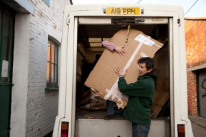 Leon from Bridport TLC brings in some cardboard for recycling